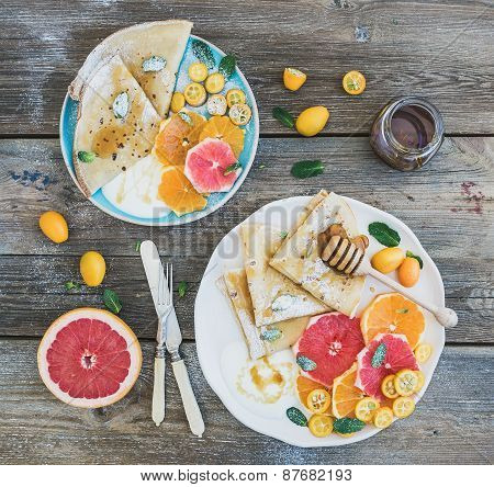 Spring Vitamin Breakfast Set. Thin Crepes Or Pancakes With Fresh Grapefruit, Orange, Kumquat, Honey,