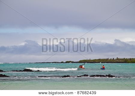 Unidentified tourists kayaking in Garraptero beach, Santa Cruz, Galapagos Islands
