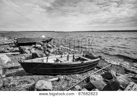 Old Fishing Motor Boat On Lake Coast