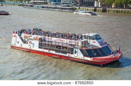 LONDON, UK - AUGUST 16, 2014: Tourist's boat. Thames river