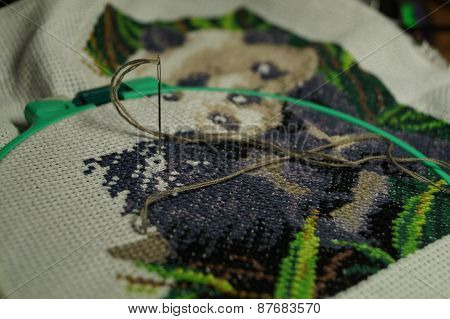 Embroidery of a picture strings of a mouline thread