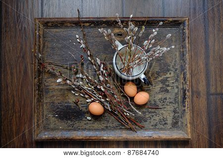 Willow branches with egg on an old vintage wood from willow