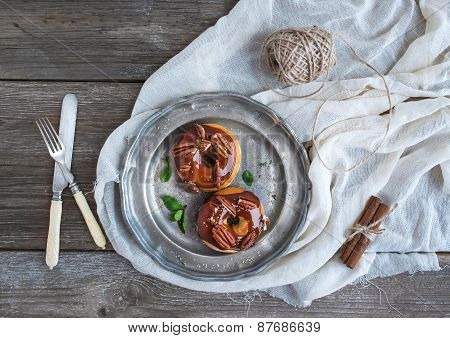 Cinnamon Donuts With Caramel Icing And Pekans Served With Fresh