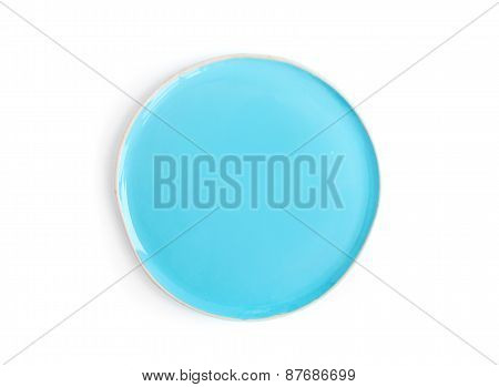 A Round Light Blue Glazed Ceramic Plate (dish) On A White Backgr