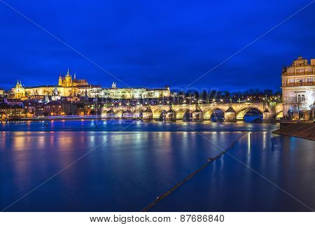 Evening View Of The Prague Castle, Charles Bridge And The Vltava