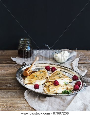 Thin Pancakes Or Crepes With Fresh Raspberry, Cream, Mint, On A