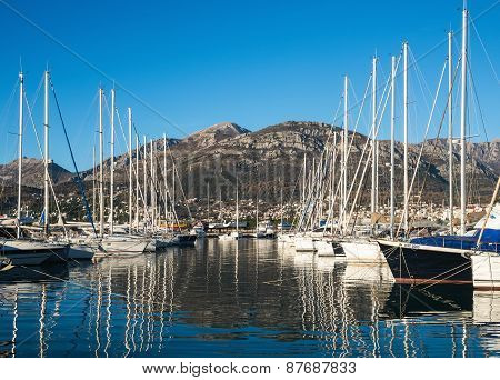 The view of yachts in the marina of Bar with mountains at the backdrop