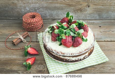 Rustic Spicy Ginger Cake With Cream-cheese Filling And Fresh Strawberries With A Rough Wood Backgrou
