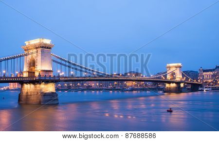 The Sunset View Of The Chain Bridge, The Danube River And Pest Side From The Buda Coast In Budapest