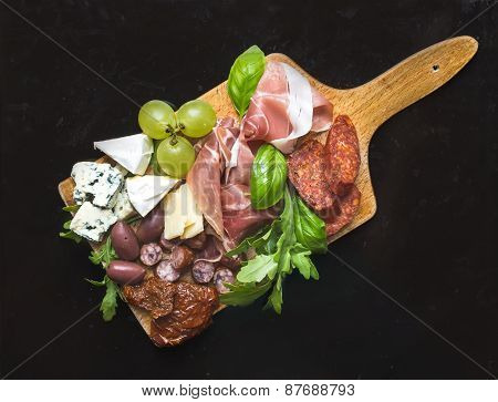 Wine Set Consisting Of Smoked Meat, Sausages, Cheese, Grapes, Cherry-tomatoes, Olives, Basil Leaves,