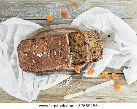 Home-made Whole Grain Bread With Dried Fruit, Seeds And Nuts On A Wooden Board