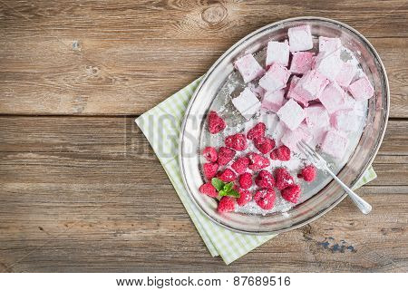 Homemade Raspberry Marshmallow With Fresh Raspberries And Sugar Powder On A Silver Dish