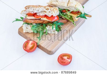 Sandwiches With Chicken Carpaccio, Parmesan Cheese, Fresh Cherry-tomatoes And Arugula In Freshly Bak