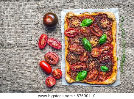 Rustic Tomato Autumn Pie With Fresh Herbs And Tomatoes On A Silver Tray Over A Sackcloth Background