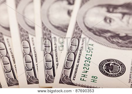 Abstract of One Hundred Dollar Bills with Narrow Depth Field.
