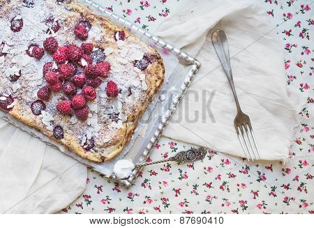 Raspberry Cottage Cheese Cake With Fresh Raspberries, Almond Petals And Sugar Powder On A Silver Tra