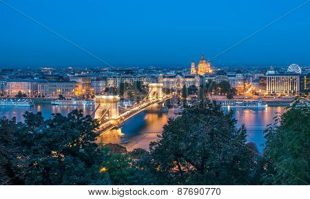 The View Of The Chain Bridge, Saint Istvan's Basilica And The Danube In Budapest From The Buda Castl