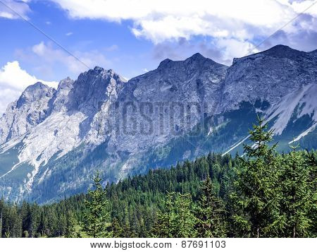 Alpine Landscape: The View Over The Green Valley, Mountains And The Sky In Alps In Austria