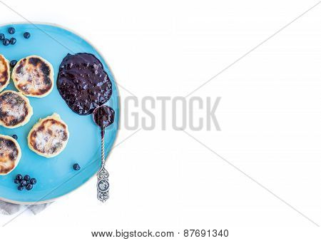 cottage Cheese Pancakes With Fresh Blackberries And Blac-currant Jam On A Blue Ceramic Plate With A
