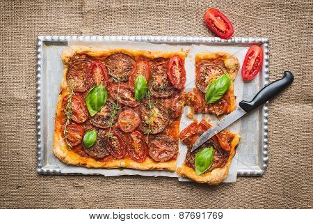 Tomato Cake With Fresh Basil And Thyme And Selection Of Fresh Tomatoes On A Wooden Board Over A Sack