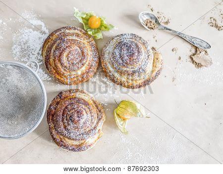 Cinnamon Buns With Sugar Powder And Ground Cherry