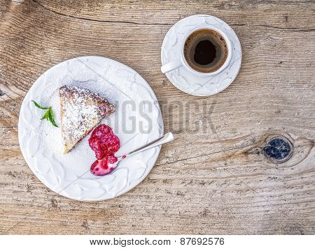 A Piece Of Raspberry Cheesecake With Raspberry Jam And A Cup Of Coffee