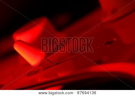 Guitar selector switch in red light