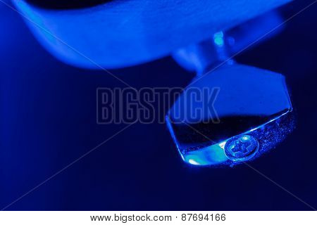 Electric guitar tuning pegs in blue light