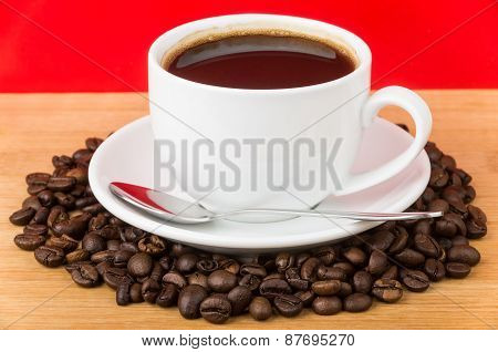 Coffee Roasted Bean And Cup On Wooden Table