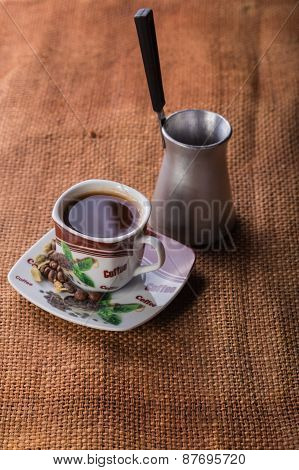A cup of coffee on the table. Coffee brewed in Arabic