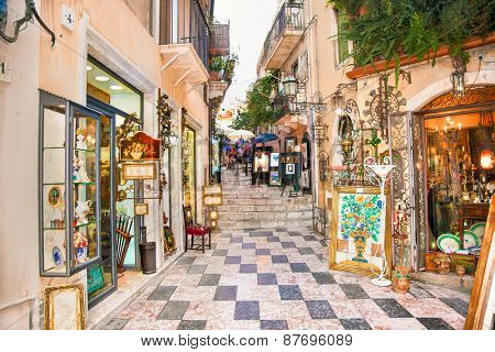 TAORMINA, SICILY - SEP 17, 2014: Tourists art corner near to the City centre on Sep 17, 2015 in Taormina, Sicily. Italiy.