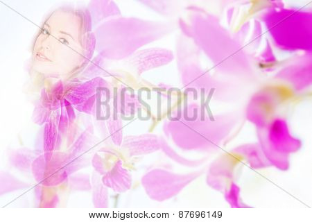 Double exposure portrait of young woman combined with photograph of fresh pink orchids background