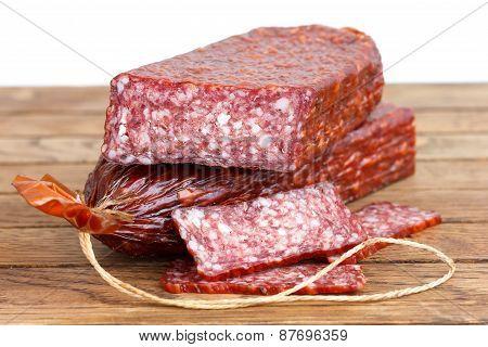 Premium stick of salami. Cut.