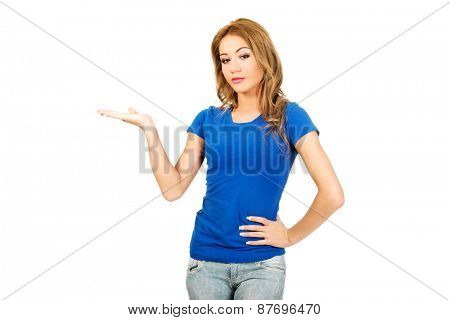 Young woman presenting a product on empty palm.