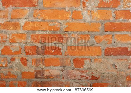 Old vintage retro brick wall.