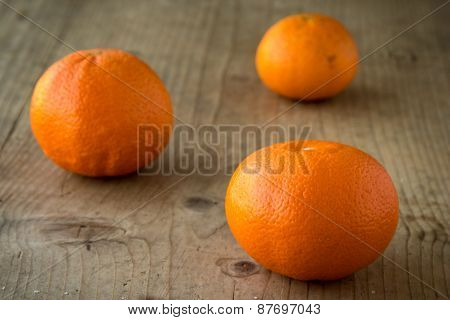 Mandarins On Wooden Table