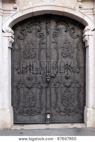 SALZBURG, AUSTRIA - DECEMBER 13: Majestic medieval door with ornate metal pattern and stone columns in Salzburg on December 13, 2014.