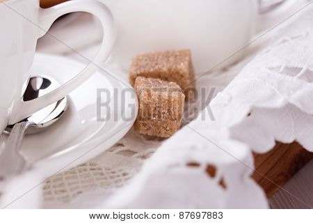 brown sugar near the white cup