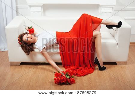 Girl Lying On A Sofa.