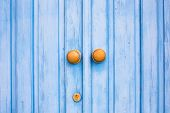 pic of door  - Yellow door knob on the blue wooden door - JPG