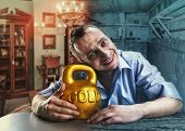 stock photo of kettlebell  - Happy man with a gold kettlebell - JPG