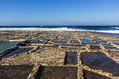 stock photo of gozo  - ancient salt in Qbajjar island of Gozo are still used for the production of sea salt - JPG