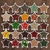 foto of fenugreek  - Large herb and spice collection in star shaped bowls over old oak background - JPG