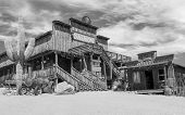 picture of wild west  - Old Wild West desert cowboy town with cactus and saloon in black and white - JPG