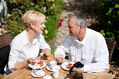 Mature couple having coffee on porch