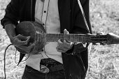 image of hillbilly  - Thailand traditional musician hillbilly playing country folk music in rice paddy field black and white - JPG