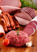 stock photo of slaughterhouse  - Assorted meat products including ham and sausages - JPG