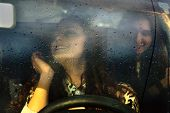 stock photo of car ride  - Two girls riding in the car - JPG