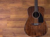 picture of fret  - Acoustic guitar leaning against the wooden wall - JPG