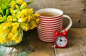 stock photo of strip  - Tea time red stripped cup of tea spring flowers and Have a nice day note